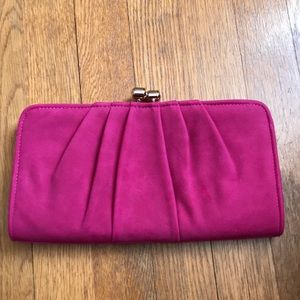 Magenta clutch with gold hardware